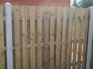 Double side rib picket in concrete posts.